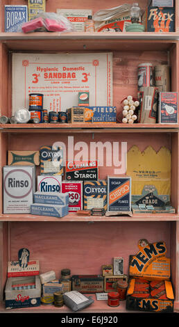 1940s replica grocers shop with packets household items on the shelves at a historical military Reenactment show. - Stock Photo