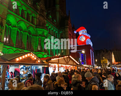 December Christmas Market in Manchester UK at night - Stock Photo