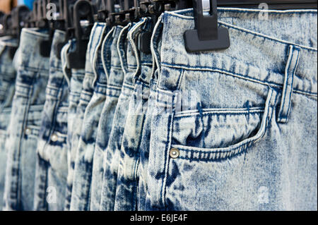 New blue jeans hanging in a shop - Stock Photo