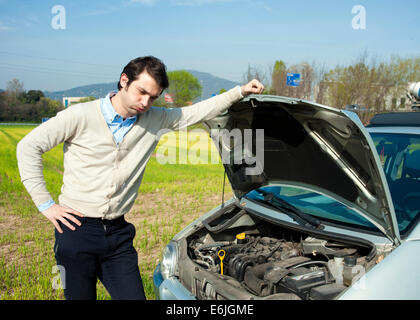 young man and car breakdown - Stock Photo