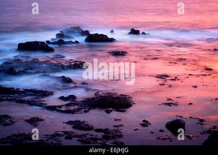 Sunset reflection at low tide. Lanai, Hawaii. - Stock Photo
