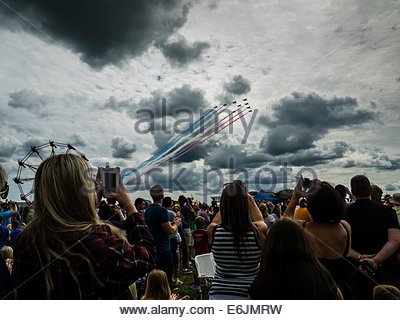 Airshow Spectators Watching Red Arrows RAF Display Dunsfold Airshow 2014 Mobile People Phone Photograph - Stock Photo
