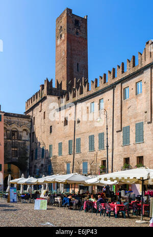 Street cafes in Piazza Sordello with the Torre della Gabbia behind, Mantua, Lombardy, Italy - Stock Photo