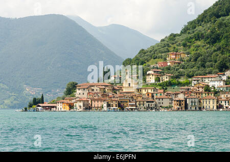 Lake Iseo or Lago d'Iseo or Sebino with the village Predore in the background. Lombardy region. Northern Italy. - Stock Photo