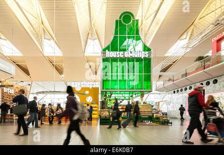 Amsterdam Schiphol Airport departure lounge 3 with Tulips Cheese souvenir souvenirs shop shops store stores passengers - Stock Photo