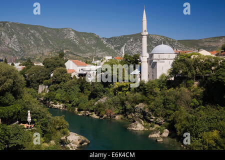 Historic centre with mosque and Neretva River, Mostar, Bosnia and Herzegovina - Stock Photo