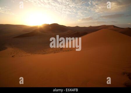 Sunrise at the Sossusvlei Dunes, Namib-Naukluft National Park, Namibia - Stock Photo