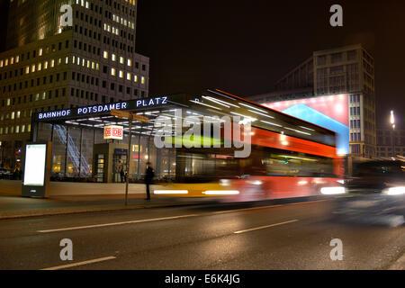 Double-decker bus at Potsdamer Platz square at night, Berlin, Germany - Stock Photo