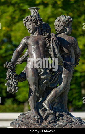 Cherub statues at the fountain basin in the water parterre, Herrenchiemsee Palace, Herrenchiemsee, Chiemsee, Chiemgau - Stock Photo