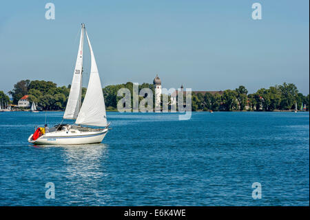 Sailboat in front of Frauenchiemsee Island, Lake Chiemsee, Chiemgau, Upper Bavaria, Bavaria, Germany - Stock Photo