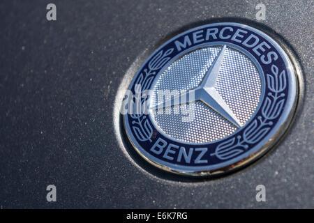 Mercedes benz logo star emblem on a grill of mercedes sl for Mercedes benz stock symbol