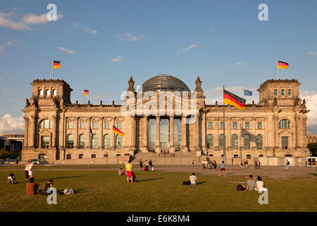 Reichstag building and german flags in Berlin, Germany, Europe - Stock Photo