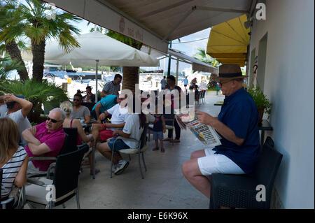 Cafe on the Harbour front in Mali Losinj, Losinj Island, Croatia - Stock Photo