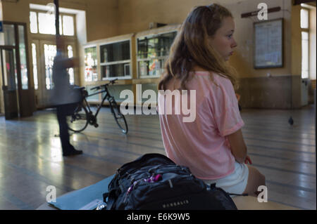 A child waits near the entrance to the Train Station in Rijeka Croatia - Stock Photo