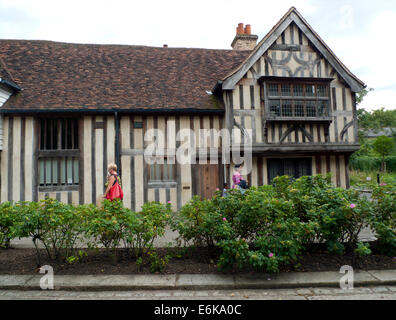 People walking on Church Lane past 'The Ancient House' in Walthamstow Village, North East London E17 UK  KATHY DEWITT - Stock Photo