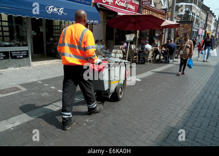 Street cleaner working in Walthamstow High Street on a sunny summer morning North East London E17 England UK  KATHY - Stock Photo