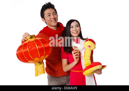 Young couple celebrating Chinese New Year - Stock Photo