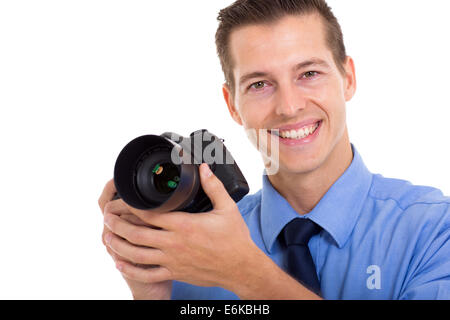 cheerful photographer holding a DSLR camera isolated on white - Stock Photo