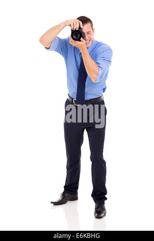 professional photographer working in studio isolated on white - Stock Photo