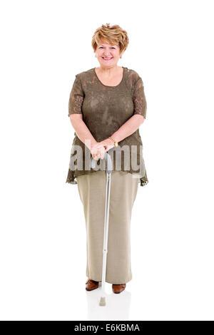 beautiful senior woman with walking stick on white background - Stock Photo