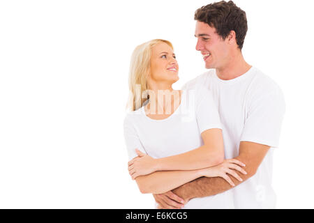 portrait of young couple hugging on white background - Stock Photo