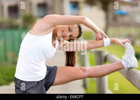 young woman stretching before exercise - Stock Photo