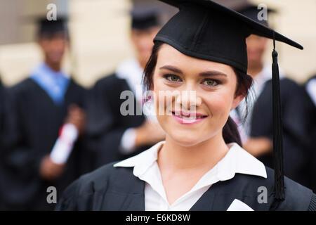 happy female graduate at graduation ceremony - Stock Photo