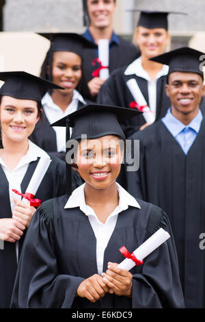 group of college students in graduation gown