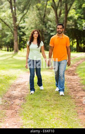 beautiful young Indian couple walking outdoors - Stock Photo