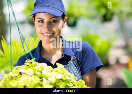 portrait of pretty young woman in garden - Stock Photo