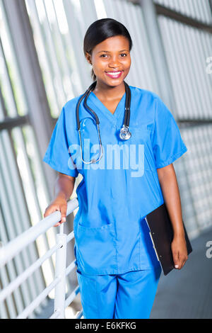 attractive female African American medical doctor holding clipboard - Stock Photo