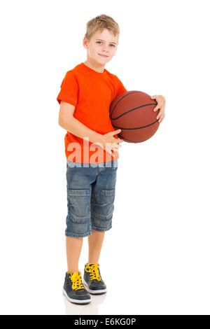 boy holding basketball isolated over white background - Stock Photo