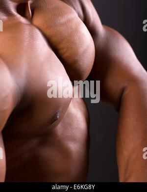 African muscular man body closeup shot - Stock Photo