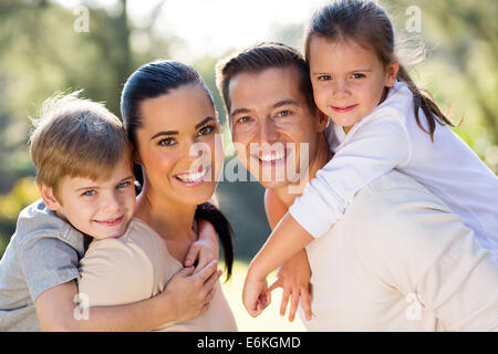 portrait of lovely young family together outdoors - Stock Photo