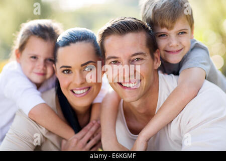 loving young family having fun together outdoors - Stock Photo
