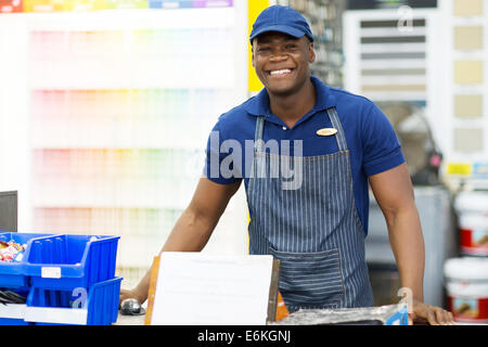 portrait of African American hardware store worker - Stock Photo