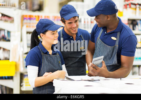 group of hardware store workers discussing work - Stock Photo