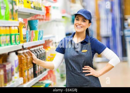 beautiful supermarket saleswoman standing in store - Stock Photo