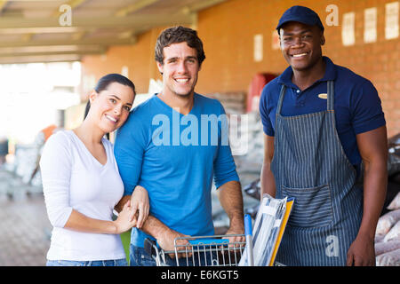 happy young couple shopping at hardware store - Stock Photo