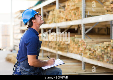 male worker working in warehouse - Stock Photo