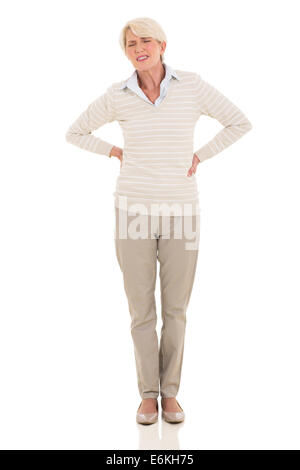 middle aged woman having back pain isolated on white background - Stock Photo