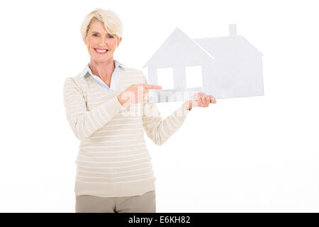 beautiful mature woman woman pointing white paper house - Stock Photo