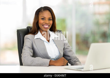 happy African American businesswoman in modern office - Stock Photo