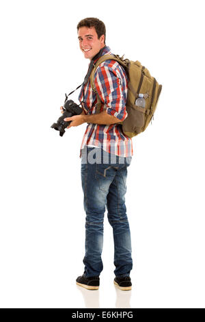 handsome young tourist looking back isolated on white - Stock Photo