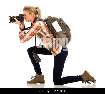 female tourist on her knee taking pictures - Stock Photo