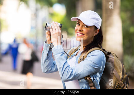 cheerful young tourist photographing in town - Stock Photo