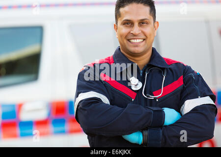 portrait of male paramedic with arms crossed - Stock Photo