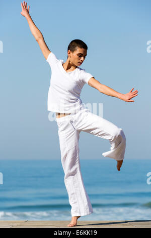 healthy young woman dancing on the beach - Stock Photo