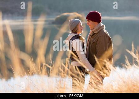 romantic couple flirting near lake - Stock Photo
