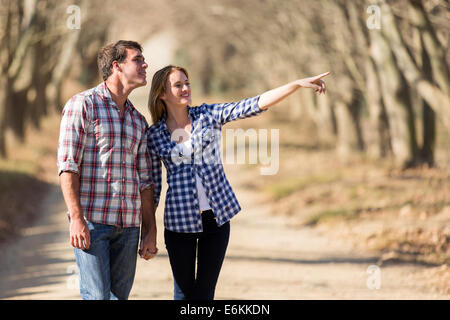 happy couple bird watching outdoors in fall - Stock Photo